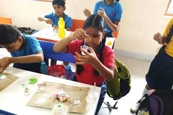 best school kompally Hyderabad EVS activity on Materials and Solution day 10