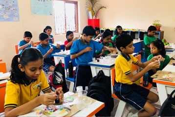 best school kompally Hyderabad EVS activity on Materials and Solution day 8